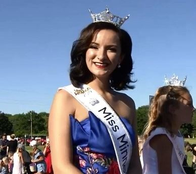 Miss Minnesota rides in the Coon Rapids 4th of July parade