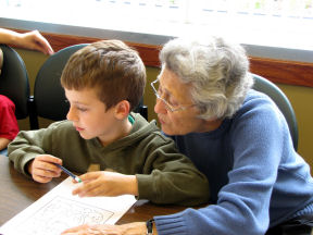 Senior citizen with young boy looking at paper